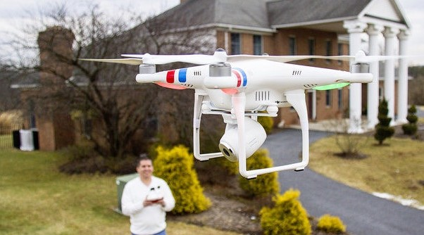 real-estate-agent-operating-a-DJI-phantom-camera-drone